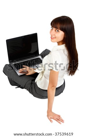 young woman using laptop pictured from rear view - stock photo
