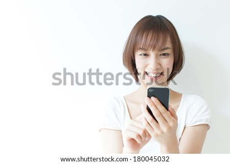 Young woman using smart phone - stock photo