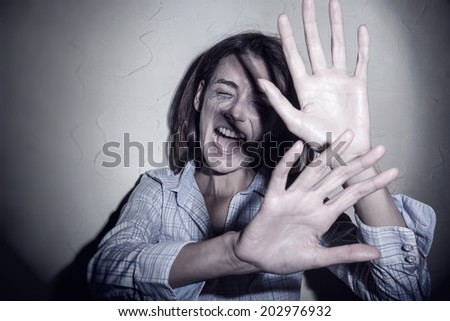 Young woman victim of domestic violence and abuse - stock photo