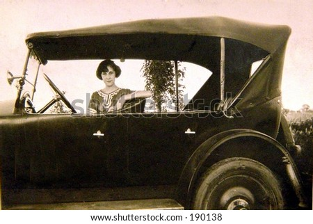 Young woman waiting in car 1920. - stock photo