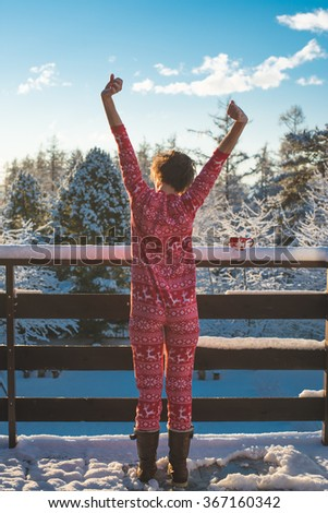 Young woman wake up happy outdoor on the balcony, freedom concept, breathing fresh air   - stock photo