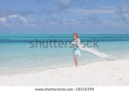Young woman walking at the beach - stock photo