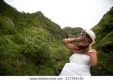 Young woman walking in beautiful lush Hawaiian forest nature landscape in mountains. Hiking women on Hawaii, Kuliouou ridge trail, Oahu, USA. Travel holidays concept. - stock photo