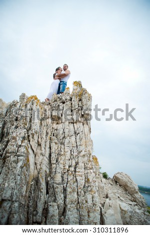young woman walking in the mountains - stock photo