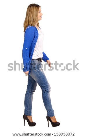 young woman walking isolated in white