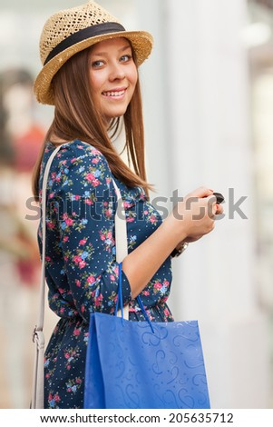 Young woman walking on the street - stock photo