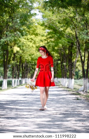 young woman walking through the forest