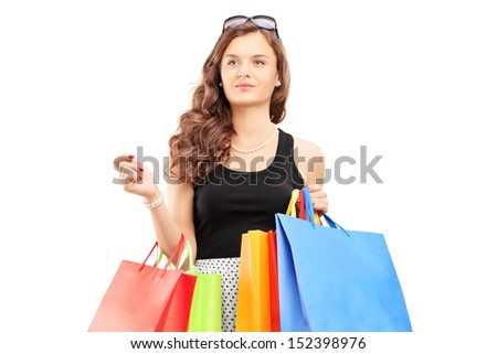 Young woman walking with shopping bags, isolated on white background