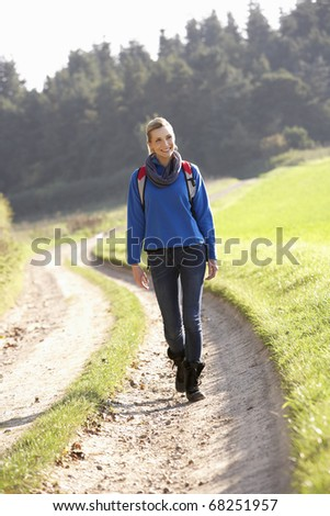 Young woman walks in park - stock photo