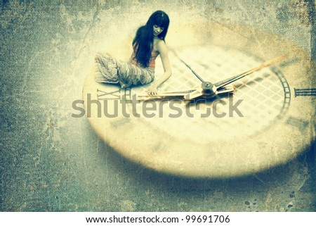 Young woman want to stop time. Old style image - stock photo