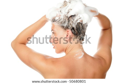 Young woman washing her hair - stock photo