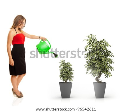 young woman watering the plants, representing a growth concept
