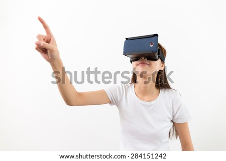 Young woman wear with with VR device and finger touch in air - stock photo
