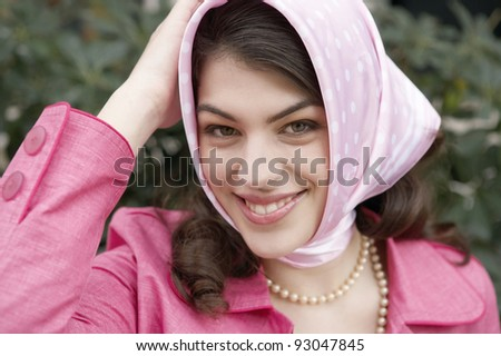 Young woman wearing a fashionable scarf on her head. - stock photo