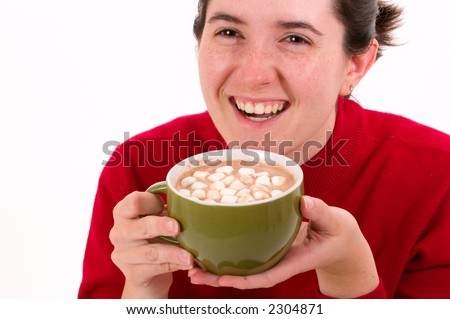 Young woman wearing a red sweater enjoys a warm cup of hot cocoa. Isolated on white. - stock photo