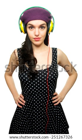 Young Woman wearing Black Polka-Dot dress and Listening to Headphones