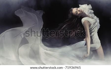 Young woman wearing gorgeous white dress - stock photo