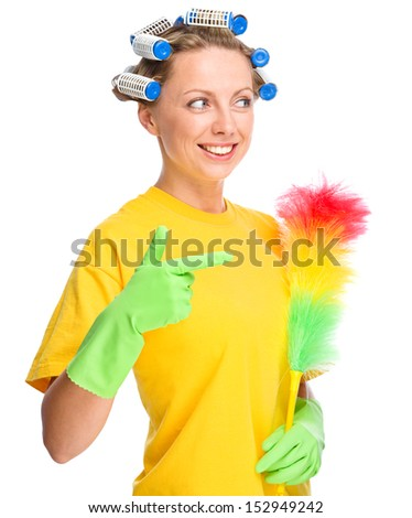 Young woman wearing hair rollers pointing to her static duster, cleaning concept, isolated over white - stock photo