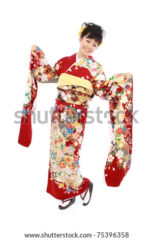 Young woman wearing Japanese kimono, isolated on white background.