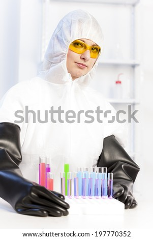 young woman wearing protective coat in laboratory - stock photo