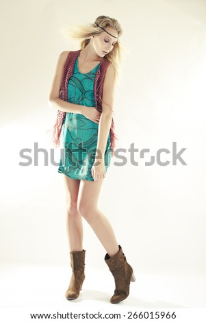 Young woman wearing Retro Hippie dress - stock photo