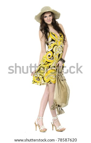 young woman wearing summer dress posing in a hat - stock photo