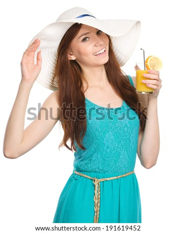 Young woman wearing summer hat and drinking orange juice, isolated over white - stock photo