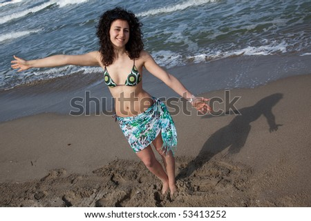 young woman wearing swimsuit at the seaside