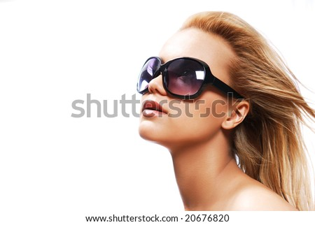 Young woman wearing the big modern sunglasses. Studio shot on a white background - stock photo