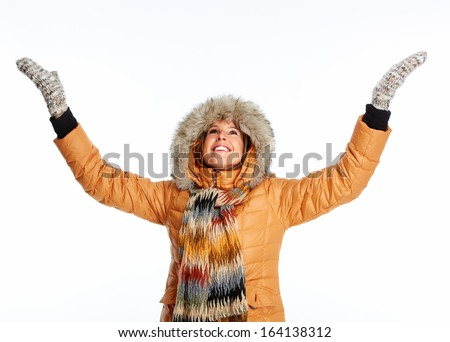 Young woman wearing winter coat isolated over white background - stock photo