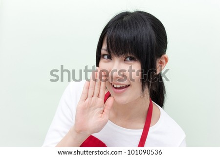 young woman whispering message - stock photo