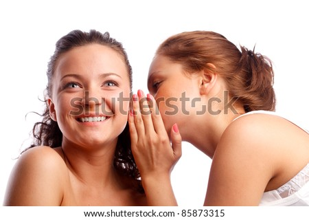 Young woman whispering something to her friend. - stock photo