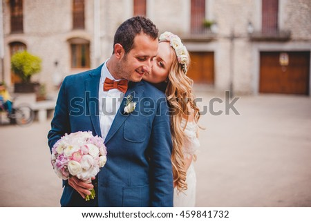 young woman whispers something in your ear groom - stock photo