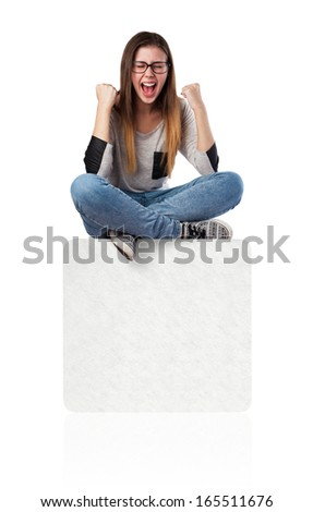 young woman winner sitting on a white box - stock photo