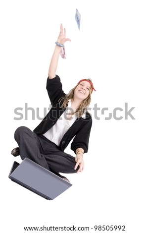 Young woman winning online flinging money in the air. Money is not in focus.