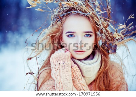 Young woman winter fashion portrait with wreath on her head. Soft light and colors - stock photo