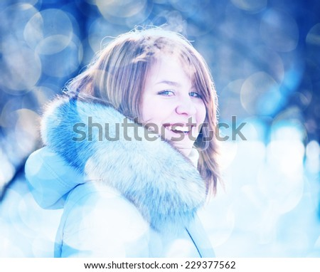 Young woman winter portrait. Shallow dof.  - stock photo