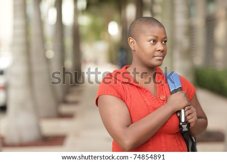 Young woman with a backpack - stock photo