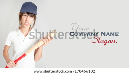 Young woman with a baseball bat and a mean expression  - stock photo