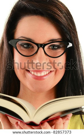 Young woman with a book isolated on white. Female student smiling - stock photo