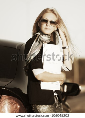 Young woman with a business papers - stock photo
