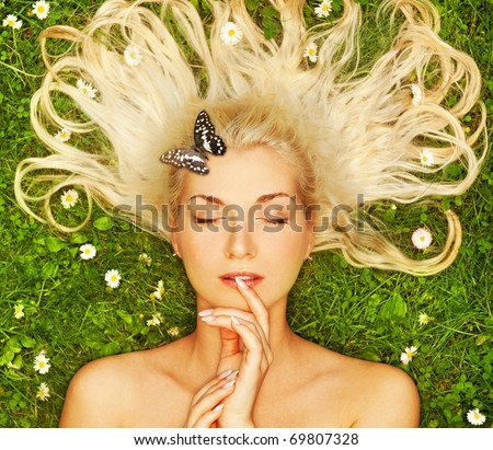 Young woman with a butterfly - stock photo