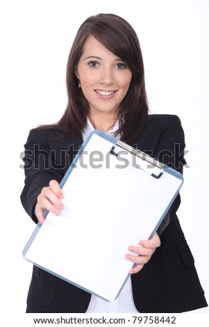 Young woman with a clipboard - stock photo