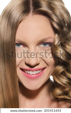 Young woman with a cold hair smiles