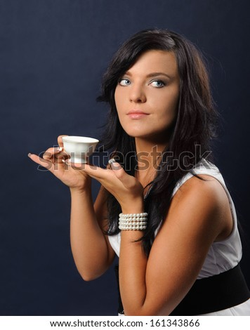 Young woman with a cup of tea - stock photo
