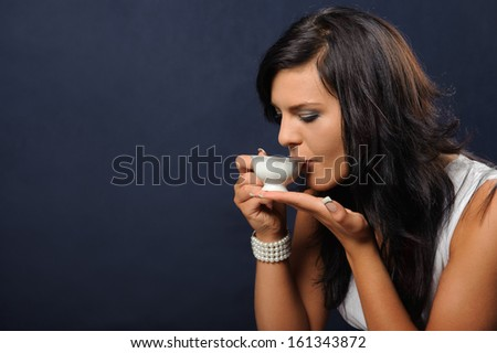 Young woman with a cup of tea