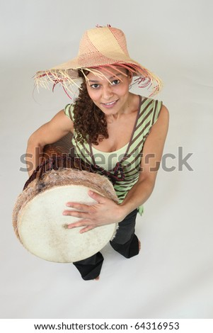 Young woman with a djembe - stock photo