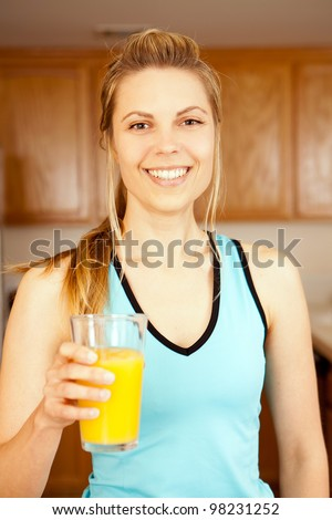 Young woman with a glass of orange juice - stock photo