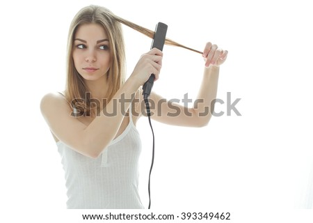 Young woman with a hair straightener