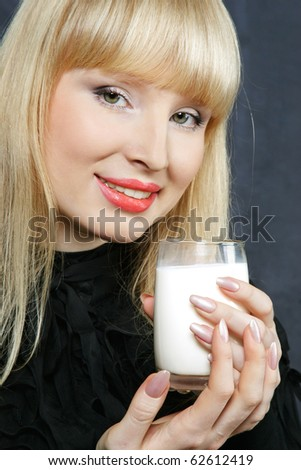 young woman with a happy drinks milk - stock photo